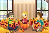Kids carving pumpkins