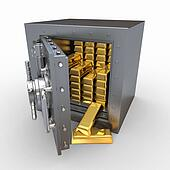 Stack of golden ingots in bank vault