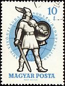 Ancient warrior with sword on post stamp