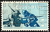 United States of America - circa 1963: a stamp printed in the United States of America shows two soldiers, Blue and Gray in the Battle of Gettysburg, circa 1963