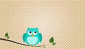 Blue stitched owl sitting on a branch