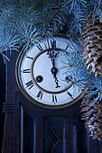 midnight antique clock and a Christmas tree