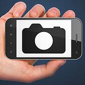 Tourism concept: Photo Camera on smartphone