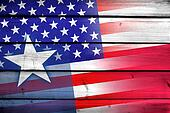 USA and Texas State Flag on wood background