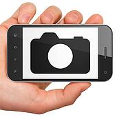 Vacation concept: Photo Camera on smartphone