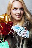 woman with money and red christmas gift