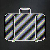 Vacation concept: Bag on chalkboard background