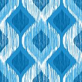 Ikat ethnic seamless pattern in blue and white colors