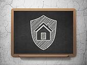 Finance concept: Shield on chalkboard background