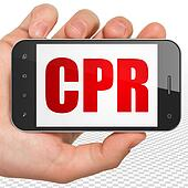Health concept: Hand Holding Smartphone with CPR on display