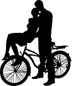 Silhouette of girl and boy and bike