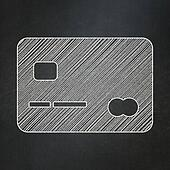 Banking concept: Credit Card on chalkboard background