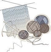 Needles, balls of wool and knitting pattern