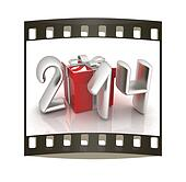 Abstract 3d illustration of text 2014 with present box. The film strip