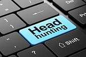 Finance concept: Head Hunting on computer keyboard background