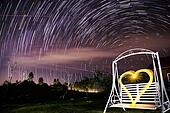 Beautiful star trail during the night and Garden swing