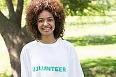 Confident female volunteer in park