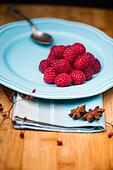 Raspberry on blue plate