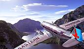 DC3 flying over mountains and lake, with blue sky and clouds on