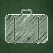 Tourism concept: Bag on chalkboard background