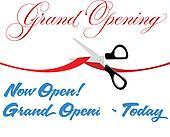 Scissors cut grand opening today ribbon