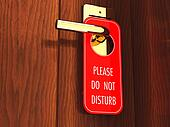 Do not disturb sign hanging on a hotel door handle, 3d illustration