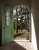 Arched Doorway to Sunlit Forest