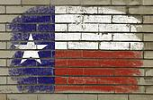 Chalky and grunge american state of texas flag painted with color chalk on brick wall