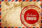 Delicious cheese sign, red grunge stamp on an airmail background