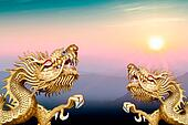twin golden dragon on morning sunrise