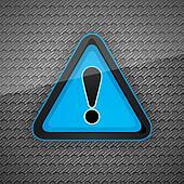 Hazard warning attention symbol on a dark gray metal surface