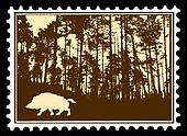 silhouette of the wild boar in wood on postage stamps