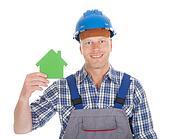 Confident Male Builder Holding Green House Model