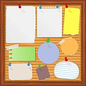 Bulletin board with old paper notes