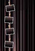 photo frames on a black curtain
