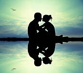 couple kissing on river