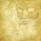 Golden Venetian mask on floral grunge texture
