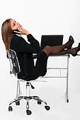 Secretary with feet on the table