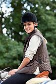 teen riding horse