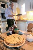 grandfather preparing a snack for his grandchildren