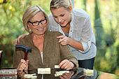 Grandmother and granddaughter playing dominoes