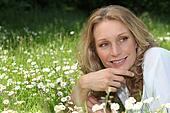 Woman lying in a meadow