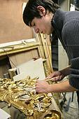 Man repairing art frame