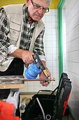 senior craftsman welding