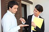 Estate agent handing over the keys to a new home