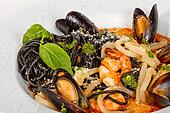 Black tagliatelle (pasta made with cuttlefish ink) with shrumps, mussel and squid