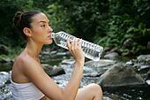 woman drinking fresh spring water