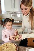 Mum and daughter making pancakes