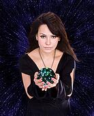 Girl with fortune telling ball against  star sky.