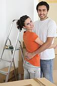 Couple hugging by ladder